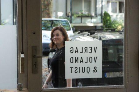 Katy Derbyshire outside the Voland & Quist office in Berlin Schönefeld